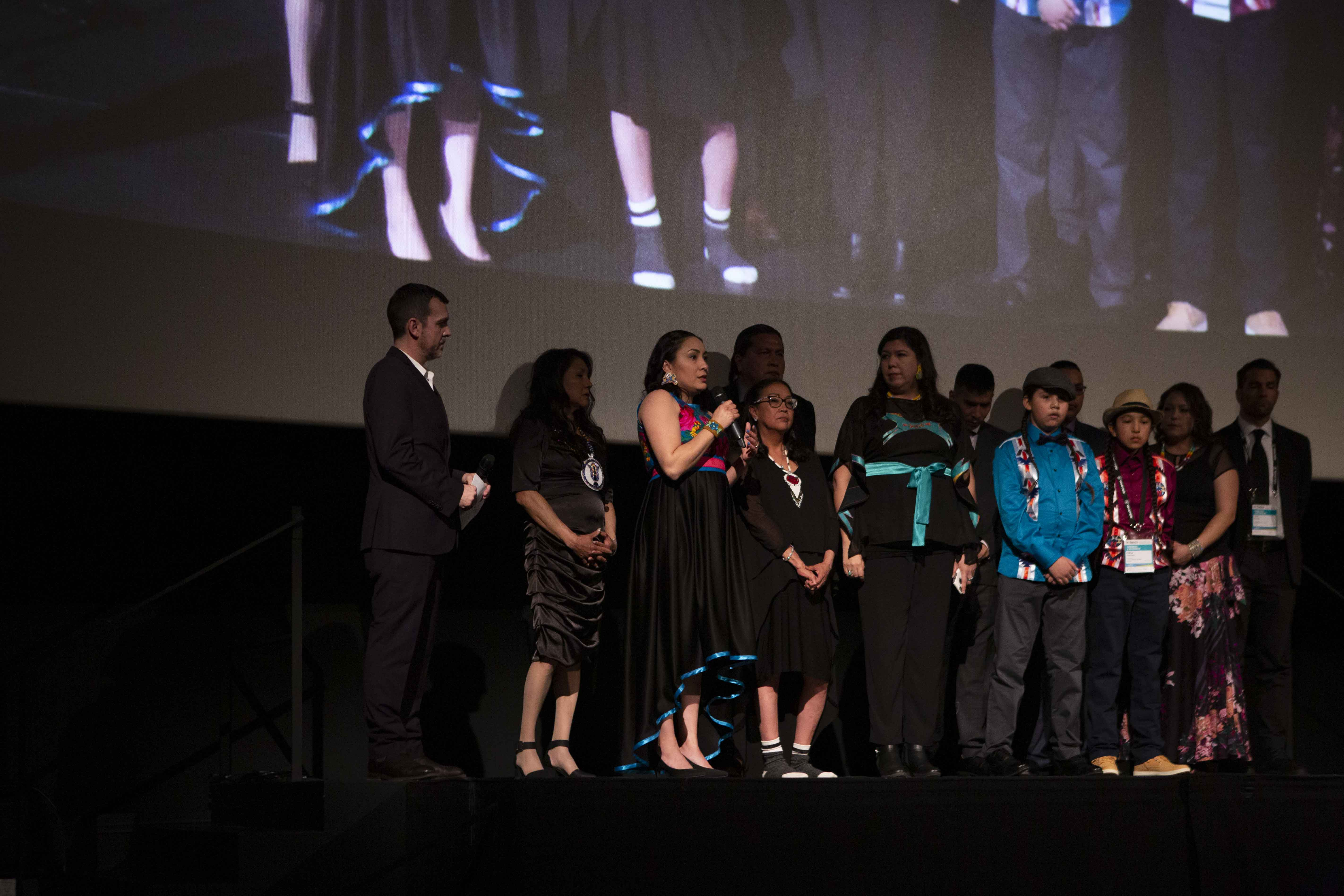 Colten Boushie's cousin, Jade Tootoosis answers a question from the audience at the HotDocs premiere of Tasha Hubbard's documentary nipawistamasowin: We Will Stand Up. (Photo by David Spowart, courtesy of Hot Docs).